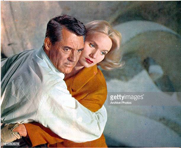 Cary Grant holding Eva Marie Saint in a scene from the film 'North By Northwest' 1959 Grant is wearing a pale grey Oxford shirt by Brooks Brothers