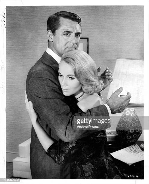 Cary Grant holding Eva Marie Saint in a scene from the film 'North By Northwest' 1959
