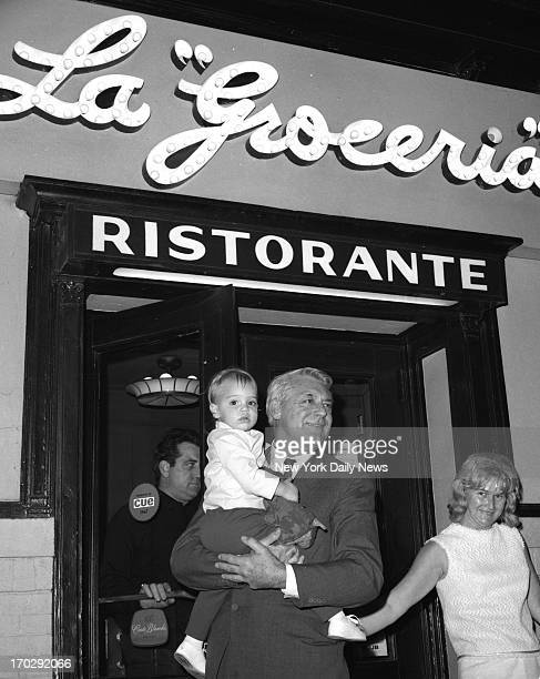 Cary Grant holds his daughter Jennifer Grant as they leave the La Groceria restaurant in Greenwich Village