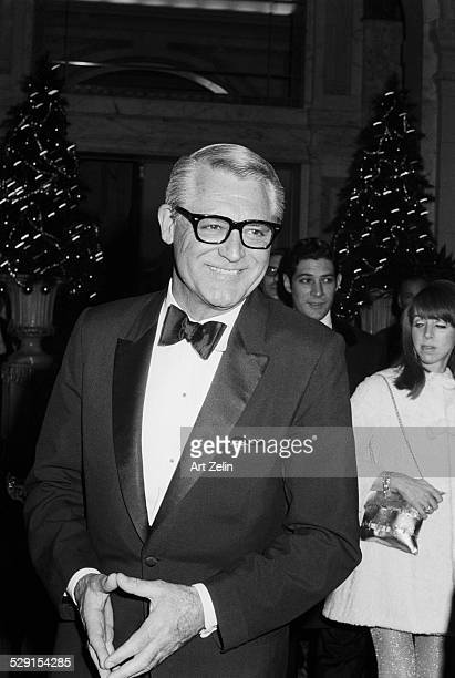 Cary Grant in a tux with Christmas trees in the background circa 1970 New York