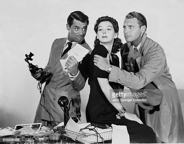 Cary Grant Rosalind Russell and Ralph Bellamy in a publicity still for His Girl Friday