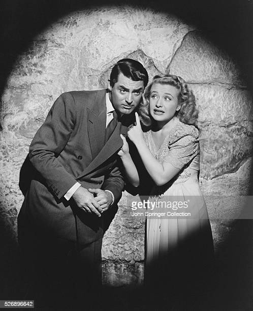 Cary Grant stars as Mortimer Brewster and Priscilla Lane as his fiancee Elaine Harper in Arsenic and Old Lace