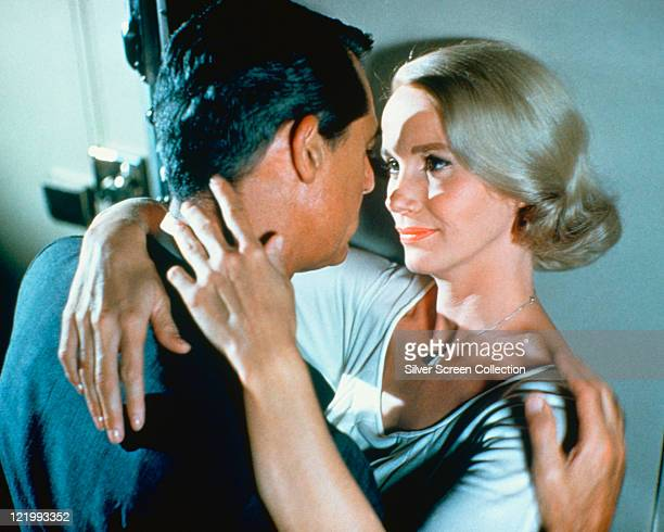 Cary Grant US actor and Eva Marie Saint US actress share a romantic moment in a publicity still issued for the film 'North by Northwest' USA 1959 The...