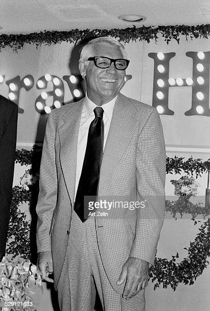 Cary Grant wearing a checked suit and dark tie at an event circa 1970 New York