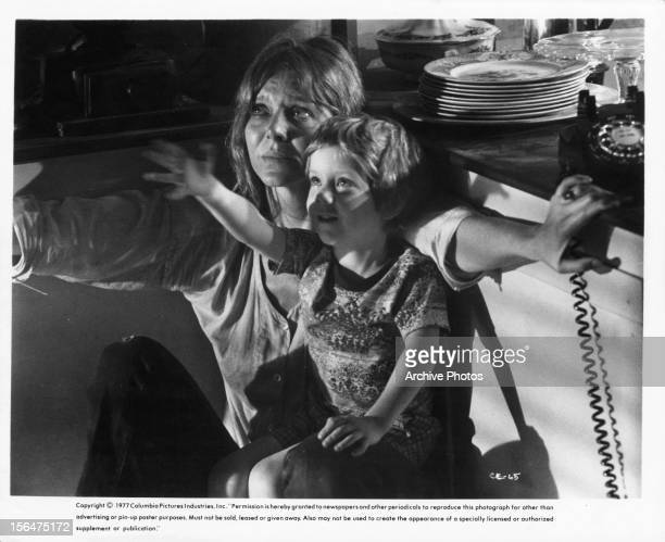 Cary Guffey sitting on Melinda Dillon's lap in a scene from the film 'Close Encounters Of The Third Kind' 1977
