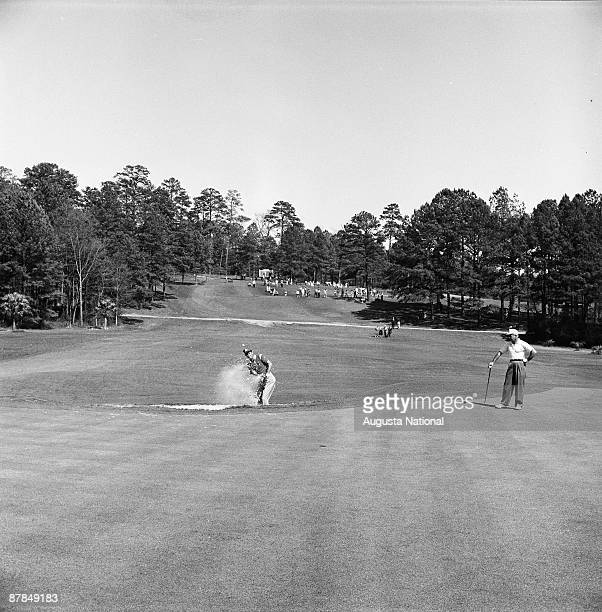 Cary Middlecoff chips out of a bunker on the fourth hole during the 1958 Masters Tournament at Augusta National Golf Club on April 6th 1958 in...
