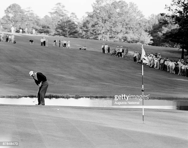 Cary Middlecoff watches his shot during the 1956 Masters Tournament at Augusta National Golf Club in April 1956 in Augusta Georgia
