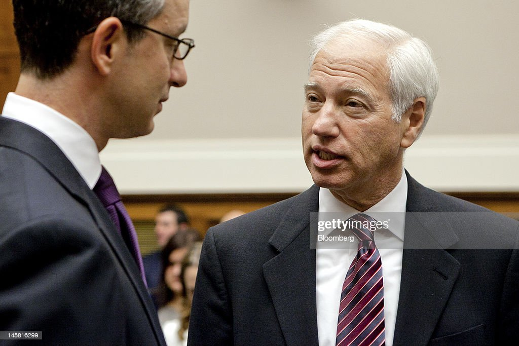 Cary Sherman, chairman and chief executive officer of the Recording Industry Association of America, right, talks to David Israelite, president and chief executive officer of the National Music Publishers' Association, prior to a House Energy and Commerce Subcommittee hearing in Washington, D.C., U.S., on Wednesday, June 6, 2012. Congress should change music-royalty rules so Pandora Media Inc. no longer pays half its revenue to artists and recording labels, Chief Strategy Officer Tim Westergren said. Photographer: Andrew Harrer/Bloomberg via Getty Images