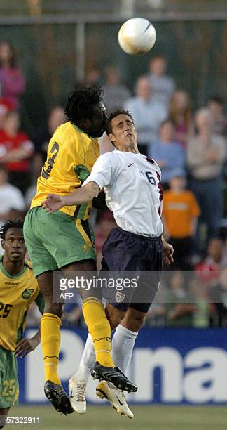 Damion Stewart of Jamaica and Kerry Zavagnin of the US jump for a header in the first half of their friendly international match at SAS Stadium in...
