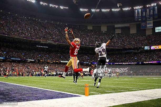 Cary Williams of the Baltimore Ravens breaks up a pass in front of Ted Ginn of the San Francisco 49ers in the third quarter during Super Bowl XLVII...