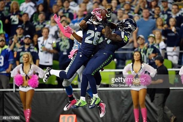 Cary Williams of the Seattle Seahawks and Kam Chancellor of the Seattle Seahawks defend a pass intended for Golden Tate of the Detroit Lions during...