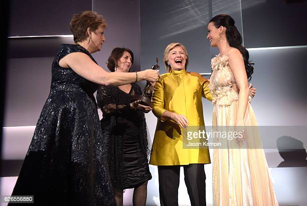 Caryl Stern Pamela Fiori and Hillary Clinton present the Audrey Hepburn Humanitarian Award to Honoree Katy Perry during the 12th annual UNICEF...