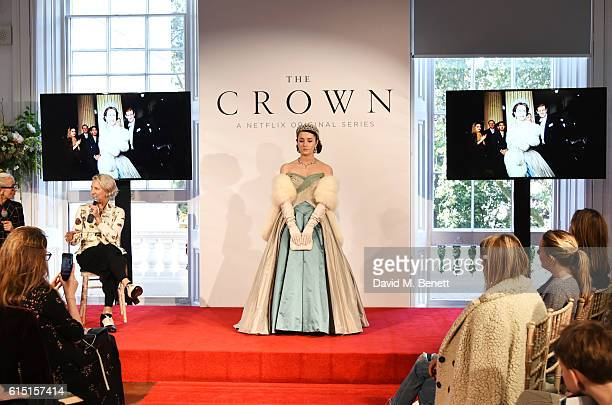 Caryn Franklin and Michele Clapton speak as a model poses at a presentation featuring costumes from new Netflix Original series The Crown with...