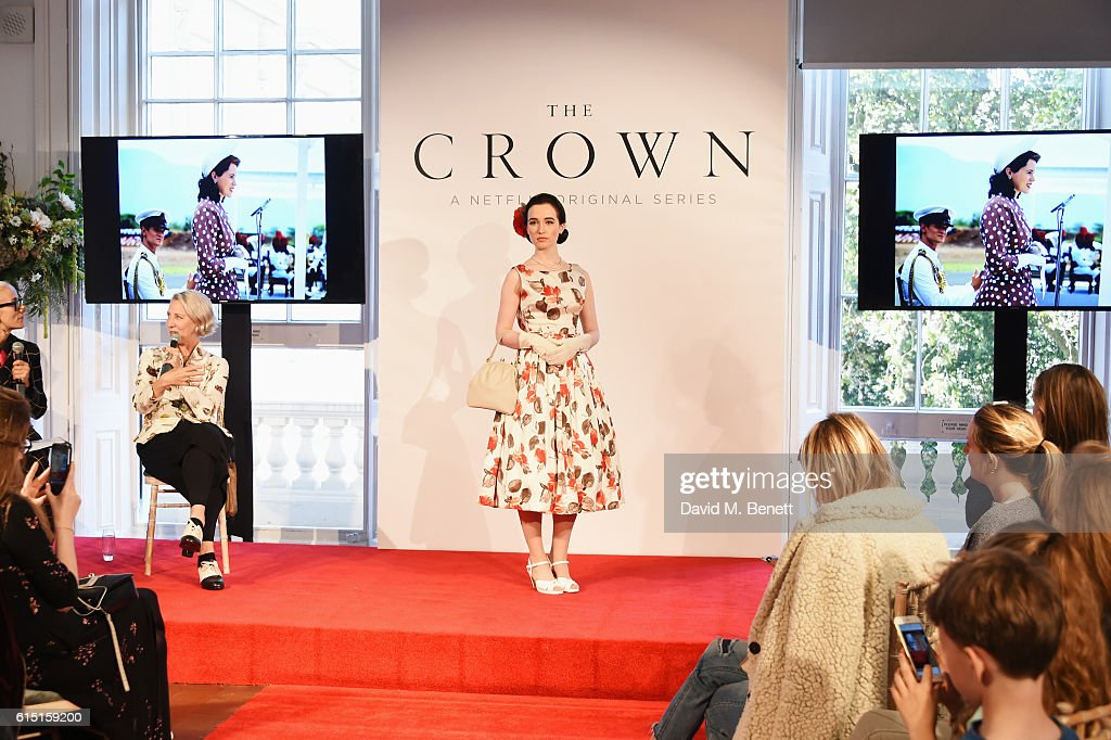 Caryn Franklin (L) and Michele Clapton speak as a model poses at a presentation featuring costumes from new Netflix Original series 'The Crown' with designer Michele Clapton at the ICA on October 17, 2016 in London, England.