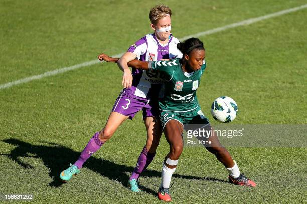 Carys Hawkins of the Glory and Madeline Washington of Canberra contest for the ball during the round 10 WLeague match between the Perth Glory and...