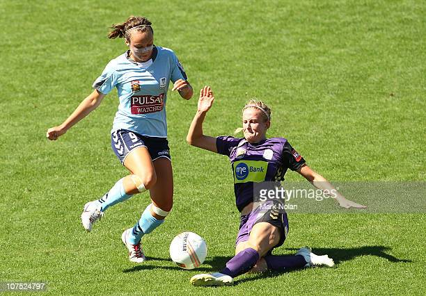 Carys Hawkins of the Glory tackles Caitlin Ford of Sydney during the round six W-League match between Sydney FC and the Perth Glory at WIN Stadium on...