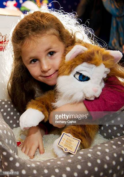 Carys Tucker plays with 'Cherry The Cat' at the Toy Retailers Association's annual 'Dream Toys' fair on October 31, 2012 in London, England. The Toy...