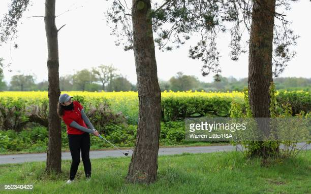 Carys Worby plays from under the trees on the second hole during the second round of the Girls' U16 Open Championship at Fulford Golf Club on April...