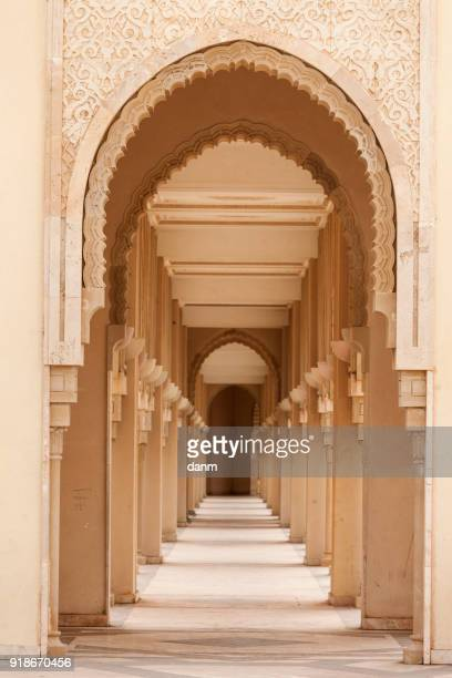 casablanca, morocco: intricate exterior marble and mosaic stone archway outside of hassan ii mosque in casablanca, morocco. - casablanca stock pictures, royalty-free photos & images