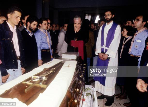 Casal di Principe Don Antonio Riboldi prays on the coffin of Don Peppe Diana killed by the Camorra during the funeral