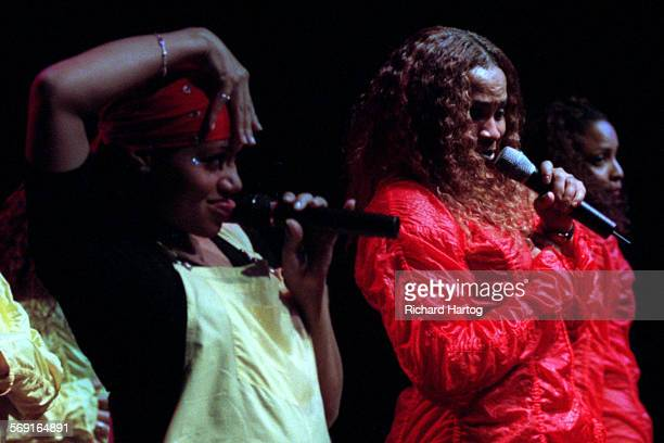 CASalt'NPepaTongueRH––041599––Salt left with Pepa right has a little fun with the crowd as the duo move it and groove it during their concert at the...