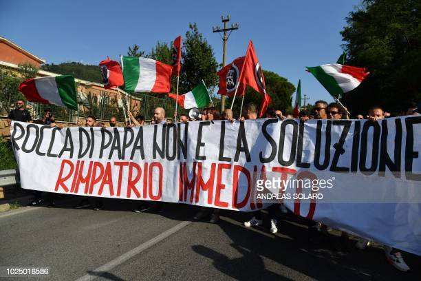 Casapound farright wing activists hold a banner reading Rocca di Papa is not a solution immediate repatriation as they protest the arrival of...