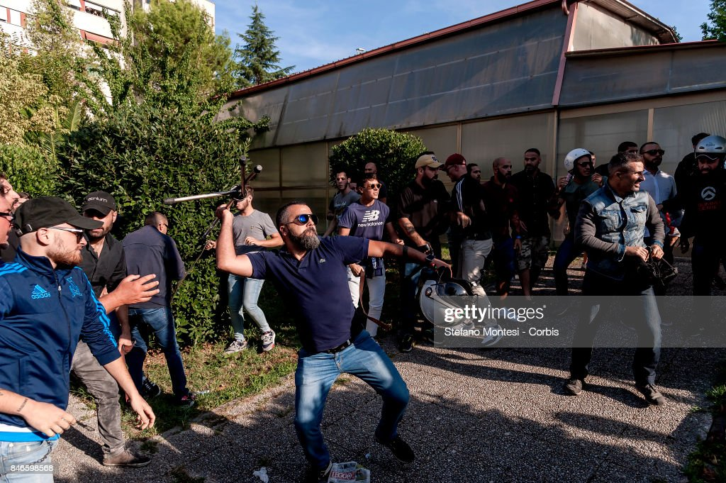 Casapound's extreme right-wing militants (pictured) clash with the anti-fascists in front of the Fourth Town Hall, where the future of a centre for refugees was discussed on September 13, 2017 in Rome, Italy. Far right movement Casapound are demanding the closure of the centre which is run by the Red Cross in District Tiburtino IV in Rome.