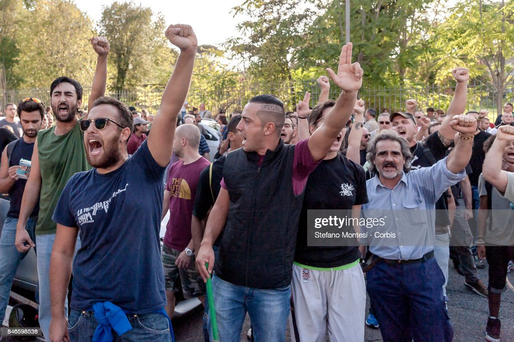 Casapound's extreme right-wing supporters shout as they clash with the anti-fascists in front of the Fourth Town Hall, where the future of a centre for refugees was discussed on September 13, 2017 in Rome, Italy. Far right movement Casapound are demanding the closure of the centre which is run by the Red Cross in District Tiburtino IV in Rome.