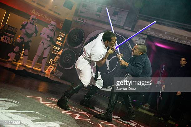 Cascade Demo Team members perform a Lightsaber fight at the Star Wars Saga release party at Virgin Megastore ChampsElysees on September 13 2011 in...