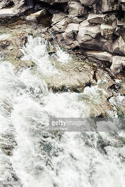 Cascade waterfall of mountain river