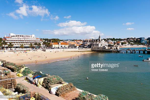 cascais beach and castle - cascais stock photos and pictures