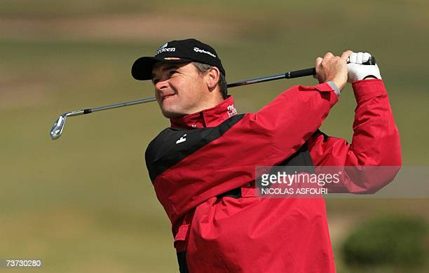 Peter Lawrie of Ireland watches his shot on the 14th fairway during the Pro amateur practice round Estoril Open in Cascais 18 kms west of Lisbon 28...