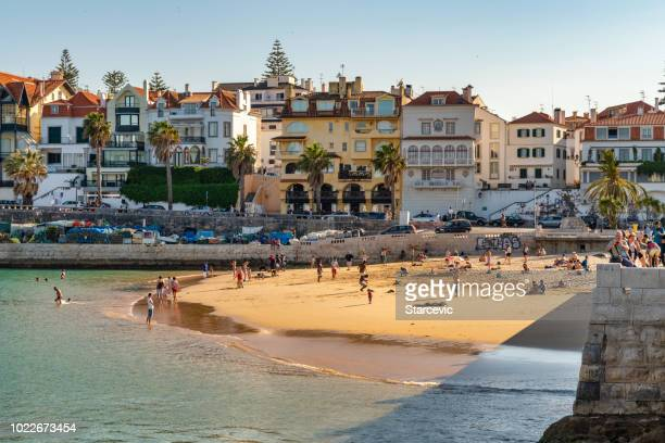cascais, portugal public beach - cascais stock photos and pictures
