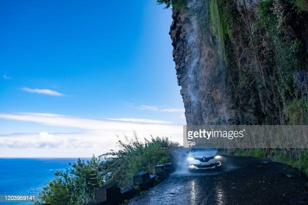 """cascata dos anjos waterfall on the coastal road of madeira island with a car driving through the falling water - """"sjoerd van der wal"""" or """"sjo"""" nature stock pictures, royalty-free photos & images"""