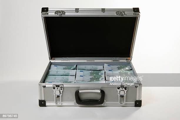 a case full of one hundred euro bills - briefcase stock photos and pictures