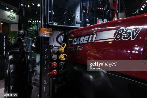 A Case IH Agricultural Equipment Inc Quantum 85v tractor sits on display at the exhibition pavilion during La Exposicion Rural agricultural and...