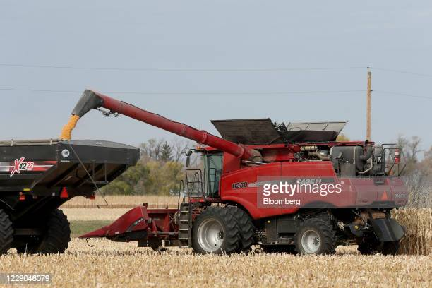A Case IH combine unloads corn during a harvest at a farm near Carman Manitoba Canada on Saturday Oct 10 2020 Costs of staples slumped at the start...