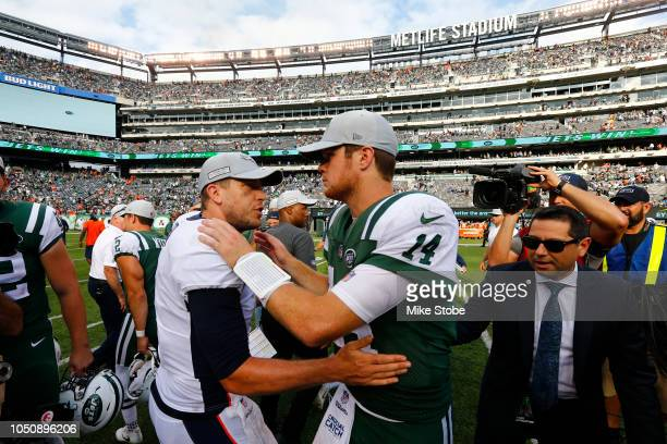 Case Keenum of the Denver Broncos congratulates Sam Darnold of the New York Jets on his win after their game at MetLife Stadium on October 07, 2018...