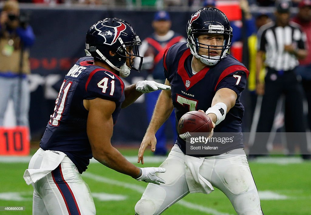Case Keenum #7 of the Houston Texans hands the football off to Jonathan Grimes on the field during their game against the Jacksonville Jaguars at NRG Stadium on December 28, 2014 in Houston, Texas.