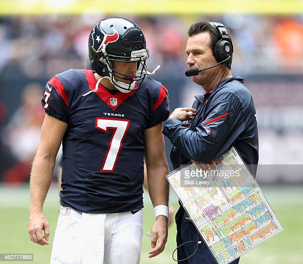 Case Keenum of the Houston Texans talks with coach Gary Kubiak during the game against the New England Patriots at Reliant Stadium on December 1 2013...