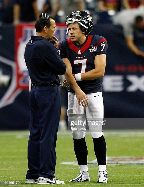 Case Keenum of the Houston Texans talks with head coach Gary Kubiak in the fourth quarter at Reliant Stadium on August 18 2012 in Houston Texas...