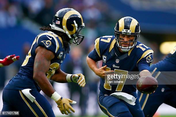 Case Keenum of the Los Angeles Rams hands off to Todd Gurley of the Los Angeles Rams during the NFL International series game between Los Angeles...