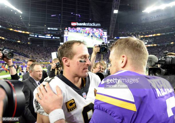 Case Keenum of the Minnesota Vikings and Drew Brees of the New Orleans Saints greet each other after the NFC Divisional Playoff game on January 14...