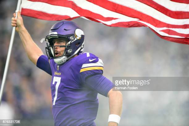 Case Keenum of the Minnesota Vikings carries out an American flag during player introductions before the game against the Los Angeles Rams on...