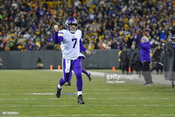 Case Keenum of the Minnesota Vikings celebrates a touchdown against the Green Bay Packers during the first half at Lambeau Field on December 23 2017...