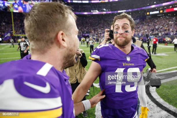 Case Keenum of the Minnesota Vikings celebrates with Adam Thielen after defeating the New Orleans Saints in the NFC Divisional Playoff game at US...