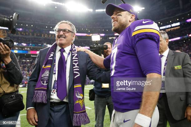 Case Keenum of the Minnesota Vikings celebrates with owner Zygi Wilf after defeating the New Orleans Saints in the NFC Divisional Playoff game at US...
