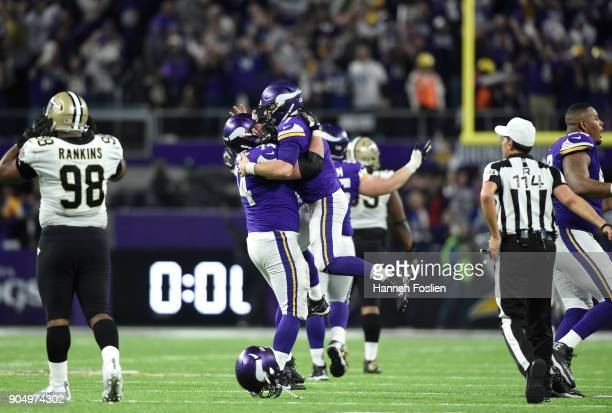 Case Keenum of the Minnesota Vikings celebrates with teammate Mike Remmers after completing a 61 yard touchdown pass to win the NFC Divisional...