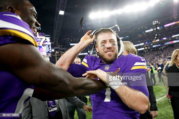 Case Keenum of the Minnesota Vikings celebrates wtih teammates after defeating the New Orleans Saints in the NFC Divisional Playoff game at US Bank...