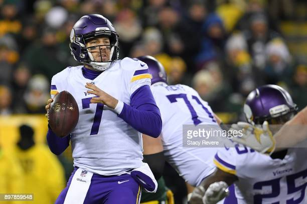 Case Keenum of the Minnesota Vikings drops back to pass during the first half against the Green Bay Packers at Lambeau Field on December 23 2017 in...